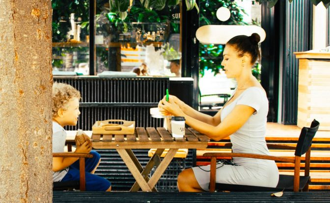 Women Eating Lunch with Boy